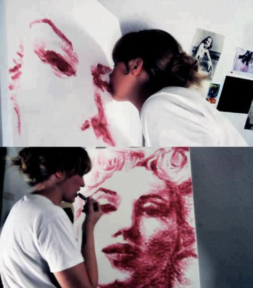 She is shown reapplying coats of lipstick to create darker tones for areas of shading.