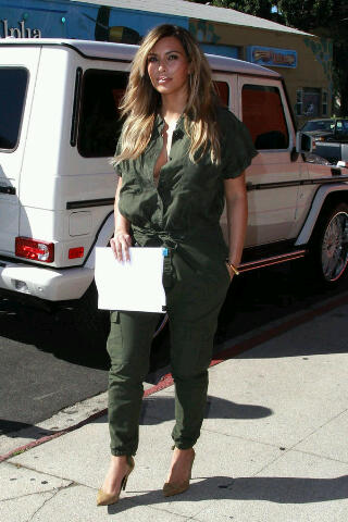 Kim Kardashian filiming her show in Los Angeles in a Green cargo jumpsuit and Saint Laurent Shoes