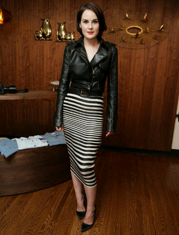Michelle Dockery in a Black leather Moto Jacket and Black and white stripped skirt